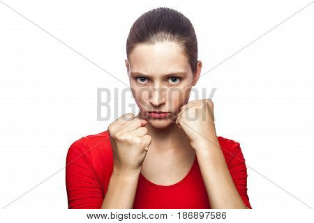 Portrait of strong boxer woman in red t-shirt with freckles with fist. looking at camera studio shot. isolated on white background.