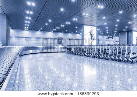 Chengdu China October 28 2016: Empty luggage conveyor belt inside of the city airport at early morning time.