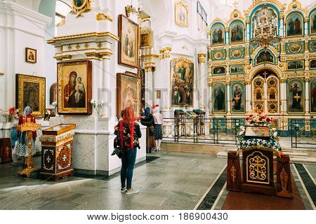 Minsk, Belarus - September 3, 2016: Woman parishioner praying in Cathedral Of Holy Spirit In Minsk. Main Orthodox Church Of Belarus And Symbol Of Old Minsk. Famous Landmark