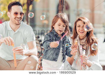 Happy family having fun in the city.