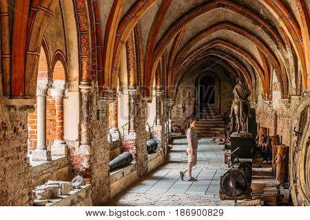 Riga, Latvia - July 2, 2016: Woman Visiting Cross Gallery In Dome Cathedral Museum.