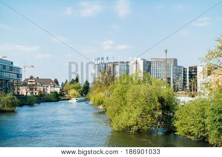 STRASBOURG, FRANCE - APR 3, 2017: European Parliament building, Council of Europe building, Arte Television building and batorama boat on a calm warm spring morning - view from above Ill river in Strasbourg
