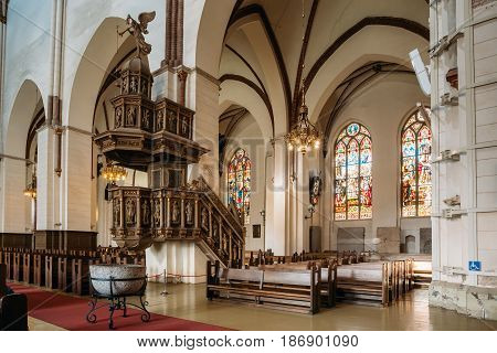 Riga, Latvia - July 2, 2016: Interior Of The Riga Dom Dome Cathedral Church. Decorative Elements, Statues On The Pulpit. Indoor