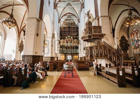 Riga, Latvia - July 2, 2016: People Visiting The Riga Dom Dome Cathedral Church