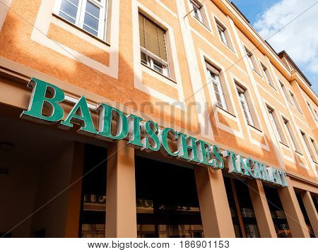 RASTATT GERMANY - APR 13 2017: Badische Tagblatt signage above the entrance of to the press building in Rastatt city. Badische Tagblatt is a newspaper covering Baden-Wurttemberg land