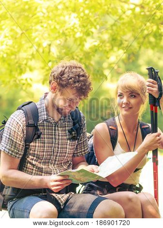 Hikers Backpackers Couple Reading Map On Trip.