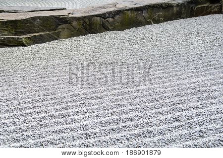 japanese zen garden grey stones and sand