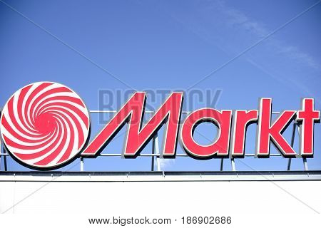MAINZ, GERMANY - MAY 14: The red illuminated company sign of the electronics and HIFI market Media Market on a modern roof edge on May 14 2017 in Mainz.