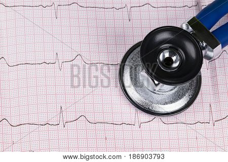 Stethoscope on the electrocardiogram (ECG) graph.Medicine concept. healthcare background