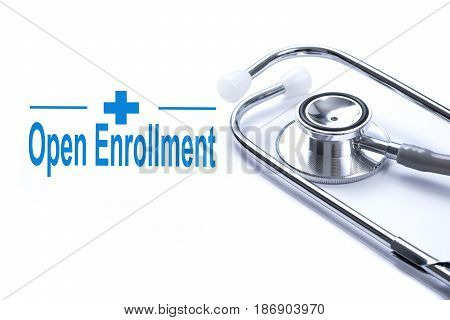 Page with Open Enrollment on the table with stethoscope medical concept.