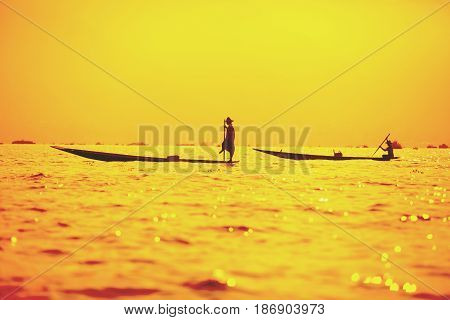 Fishermen at dawn catching fish on Inle Lake Myanmar