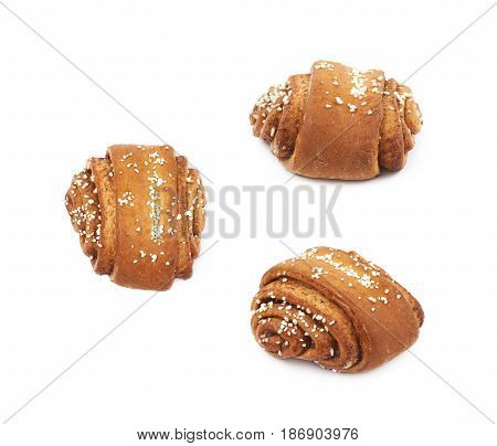 Cinnamon roll pastry bun isolated over the white background, set of three different foreshortenings