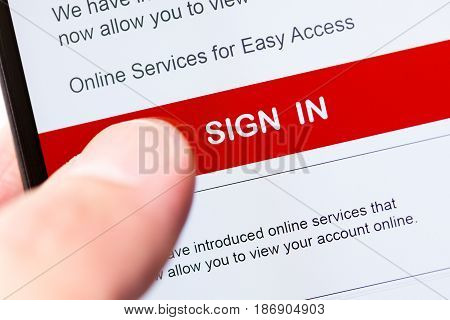 smartphone touch screen with red button sign in. business e-commerce concept.