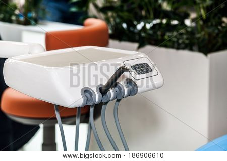 Medical tools in modern dental office, dentist room interior. Stomatology instruments background