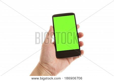 hand holding and showing smartphone with green screen. Isolated on white background