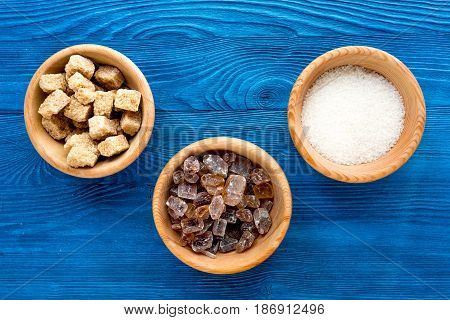 cooking sweets set with sugar in bowls on kitchen blue table background top view