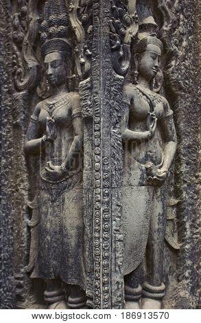 Figure details in Ta Prohm Temple Cambodia.