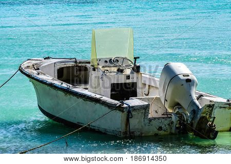Small, derelict boat on Caribbean beach in BVI