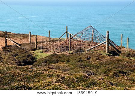 Steel Protective Grid Covering The Opening Of A Disused Tin Mine Shaft On The Atlantic Coast Of Corn