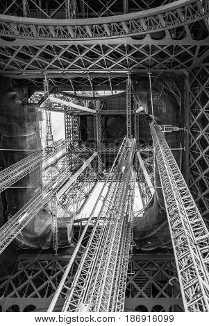 Standing under Eiffel Tower Tour Eiffel blue sky clouds black and white
