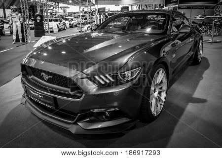 STUTTGART GERMANY - MARCH 03 2017: Pony car Ford Mustang GT V8 Fastback Coupe 2016. Black and white. Europe's greatest classic car exhibition