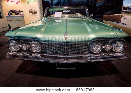 STUTTGART GERMANY - MARCH 03 2017: Full-size car Oldsmobile Super 88 Convertible 1959. Europe's greatest classic car exhibition