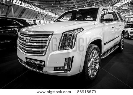 STUTTGART GERMANY - MARCH 03 2017: Full-size luxury SUV Cadillac Escalade Platinum 2017. Black and white. Europe's greatest classic car exhibition