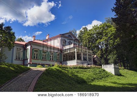 The ancient wooden house in the noble estate in Russia in summer