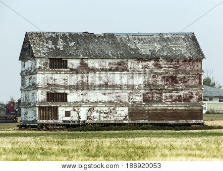 A large barn in Alberta Canada in rough shape.