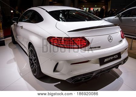STUTTGART GERMANY - MARCH 03 2017: Compact luxury car Mercedes-AMG C63 S Coupe 2016. Rear view. Europe's greatest classic car exhibition