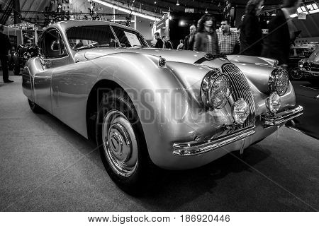 STUTTGART GERMANY - MARCH 03 2017: Sports car Jaguar XK120 Coupe 1953. Black and white. Europe's greatest classic car exhibition