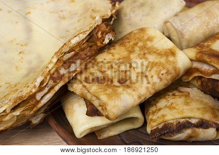 Freshly baked pancakes and wrapped with meat