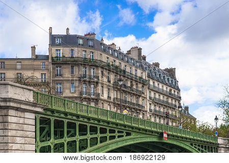 Paris France - May 1 2017: Ancient architecture along the banks of the Seine close to Pont Sully Bridge on May 1 2017 at Paris France.