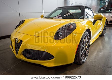STUTTGART GERMANY - MARCH 03 2017: Sports car Alfa Romeo 4C Spider (Type 960) 2015. Europe's greatest classic car exhibition