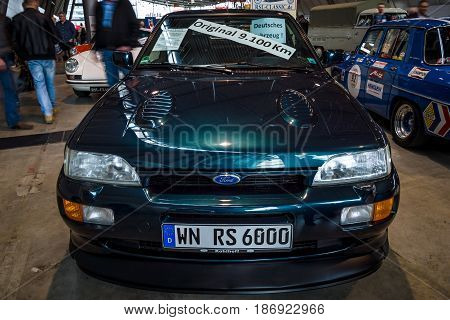 STUTTGART GERMANY - MARCH 03 2017: Rally special car Ford Escort RS Cosworth 1993. Europe's greatest classic car exhibition