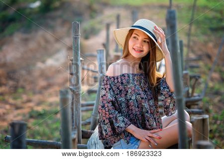 Asia Woman In Summer Fashion Sitting On Sun