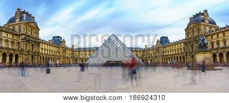 Paris France - May 1 2017: Panoramic view of the Louvre Museum (Musee Du Louvre) with a cloudy day on May 1 2017 in Paris France.