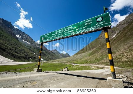 Border sign at the beautiful mountain view on the way to Rangdum Kashmir state India.