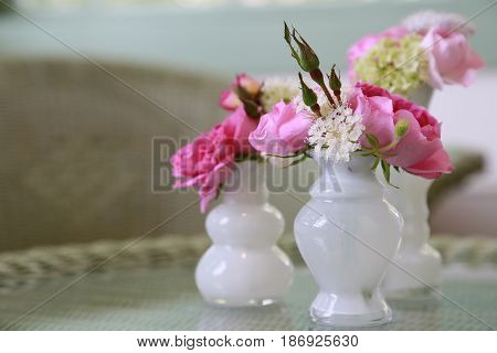 Spectacle of flower decoration on the table in the room
