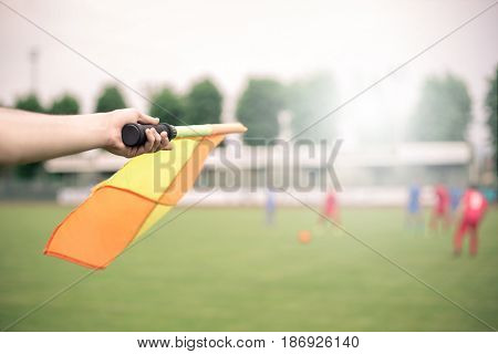 Lineman on the field showing a flag