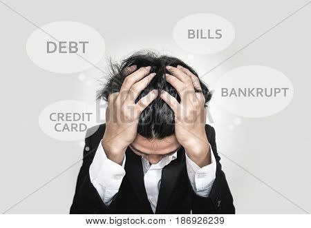 Stressed businessman with speech bubbles, concept of financial problems