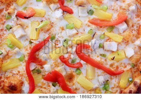 Pizza. Hawaiian Pizza with Pineapple, Bell Peppers, Ham and Bacon bits. Isolated on white. Room for text.