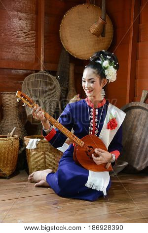 NAKORN PHANOM THAILAND - FEBRUARY 14 2015: Thai northeastern Phutai musician with traditional music equipment in Phutai world event day in Renunakorn of Nakorn Phanom Thailand.