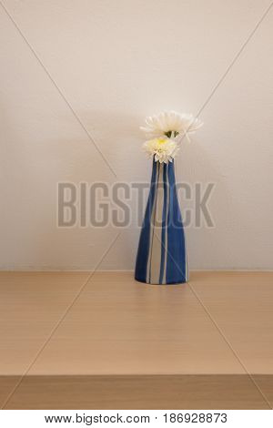 White Flowers Vase Decorated On Table stock photo