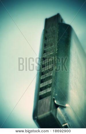 Close up of blues harmonica , shallow DOF retro style toned photo