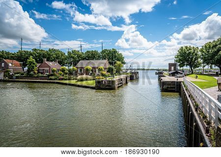Enkhuizen Netherlands - August 5 2016: Old harbour of Enkhuizen a cloudy day . At the peak of its power Enkhuizen was one of the most important harbour cities in the Netherlands