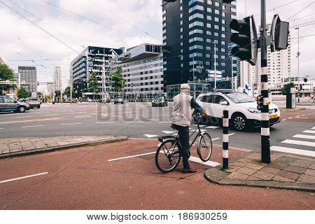 Rottedam The Netherlands - August 6 2016: Rotterdam cityscape and car traffic in a crossroads. Rotterdam is home to some world famous architecture from renowned architects