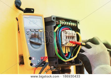 electricianHand of electrician on the job function check electical system