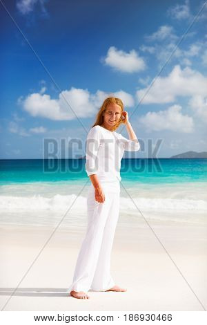 Photo of a young woman heaving rest on the beach