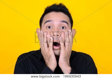 A man expressing shocked and scared face